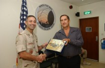 Marko in the Middle East receiving an Outstanding Civilian of the month award.